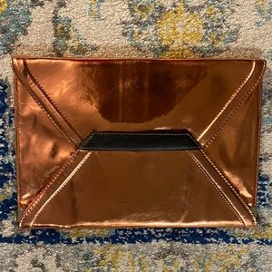 Handbags - NWOT Copper Clutch from Urban Outfitters